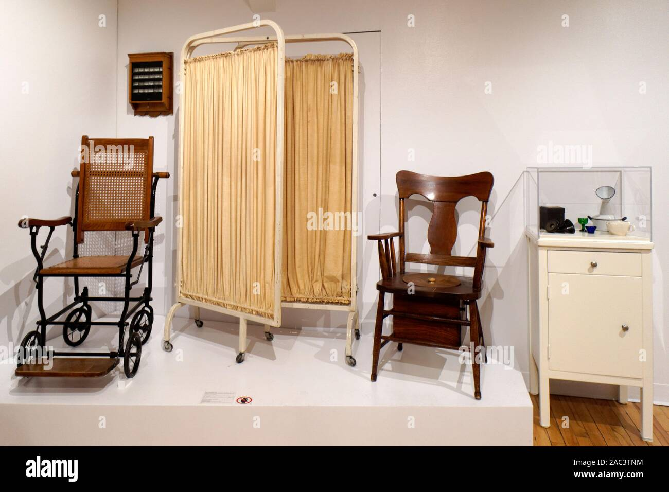 Nursing infirmary display with antique nursing equipment from the late 19th and early 20th centuries Stock Photo