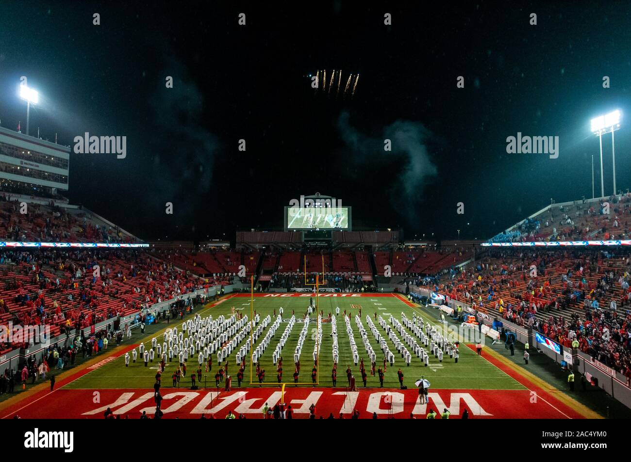 Raleigh, North Carolina, USA. 30th Nov, 2019. Nov. 30, 2019 - Raleigh, North Carolina, USA - The NC State band, 'The Most Dangerous Band in the South, ' plays the National Anthem as a aerial demonstration team flies over Carter-Finley Stadium before Saturday's game between the NC State Wolfpack and University of North Carolina Tar Heels. The Tar Heels defeated the Wolfpack, 41-10. Credit: Timothy L. Hale/ZUMA Wire/Alamy Live News Stock Photo