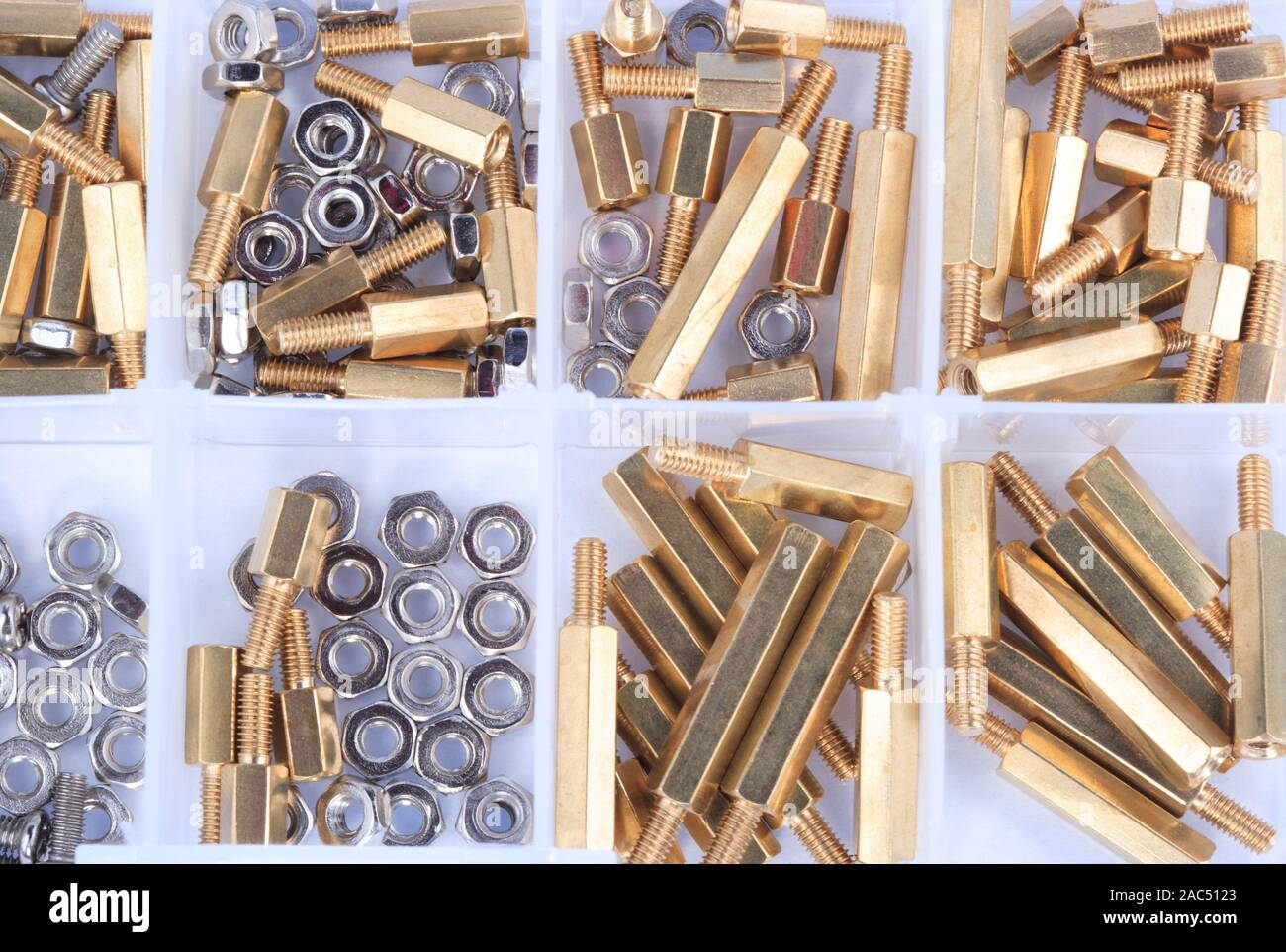 Brass Standoff Spacer Male and Female set in plastic container Stock Photo