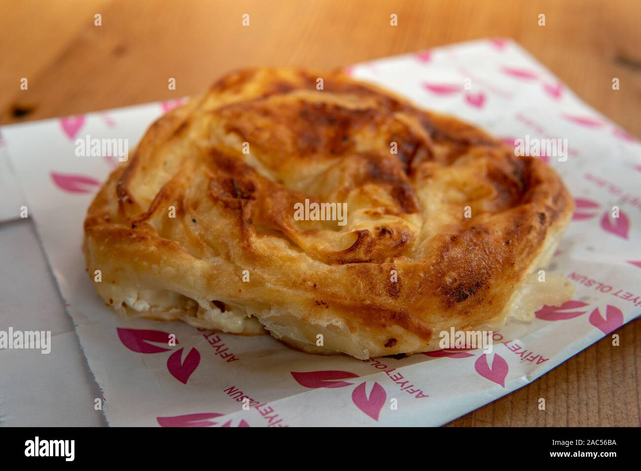 Borek is a family of baked filled pastries made of a thin flaky dough such as phyllo or yufka, of Anatolian origins and also found in the cuisines of Stock Photo