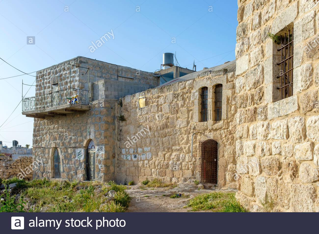 Historic buildings in ad-Dhahiriya, founded in thirteenth century by the Mamluk ruler Al-Malik al-Dhahir Baibars, Hebron Governorate, West Bank, Pales Stock Photo