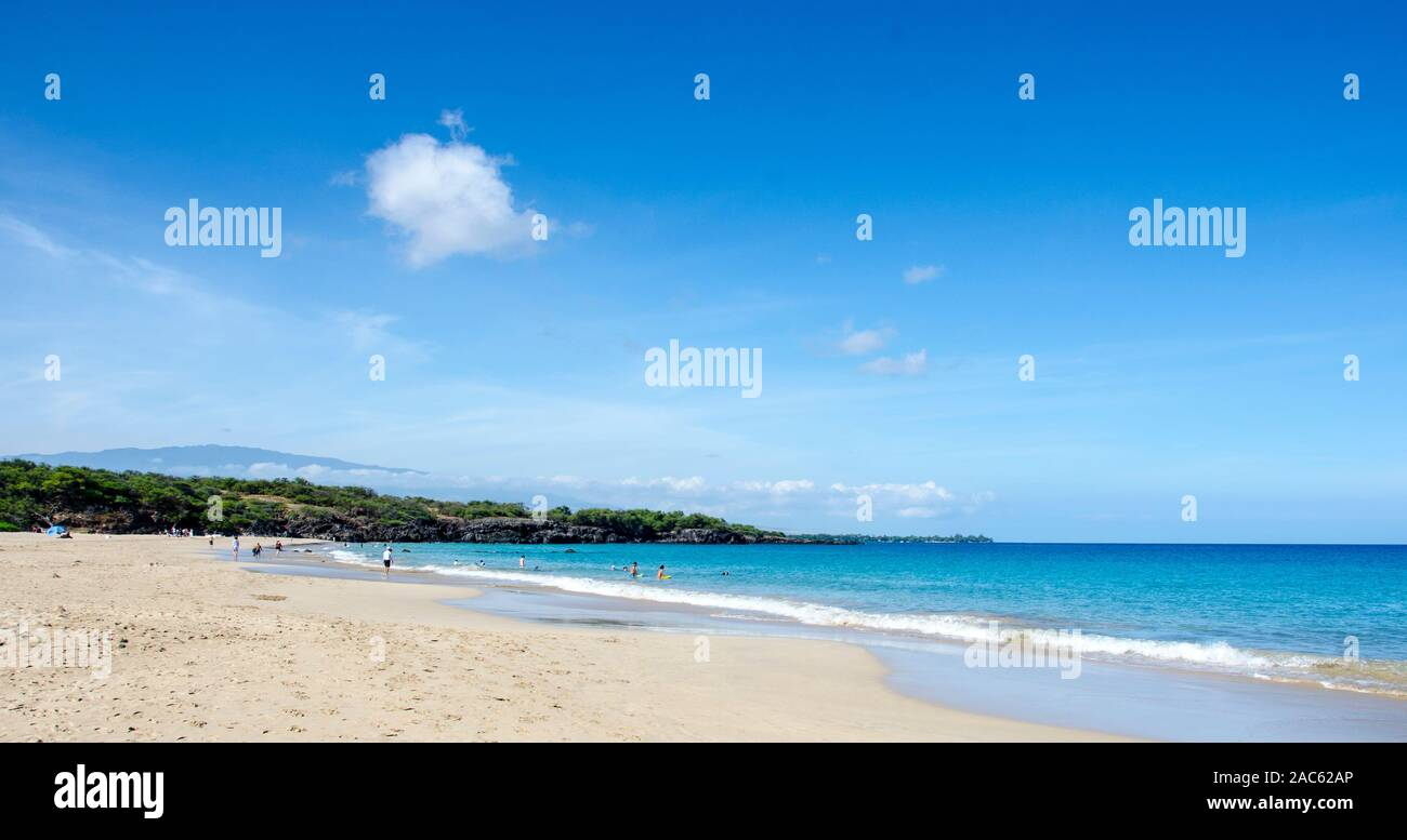 Hapuna Beach, along the Big Island of Hawai'i's Kohala Coast with Hualalai mountain in background. This white sand beach has been rated one of the bes Stock Photo