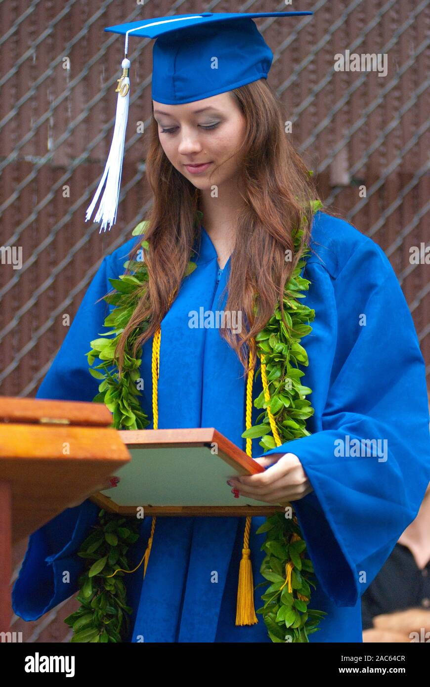 High school graduation from Academy of the Pacific, now a closed private school, in Honolulu, on the island of O'ahu. Stock Photo