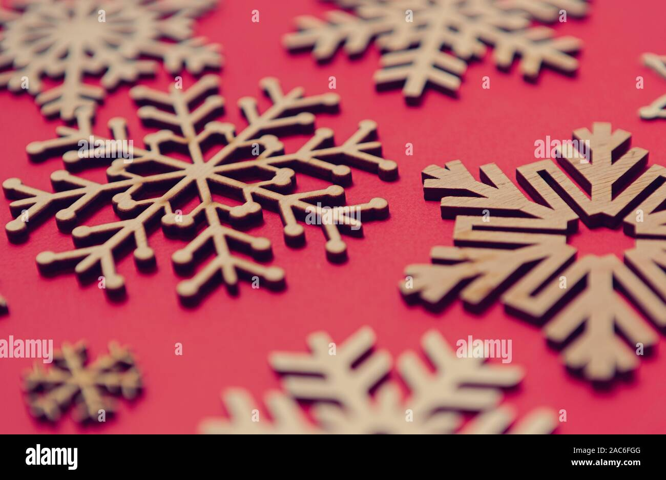 Rustic Wooden Snowflakes On Red Christmas Background
