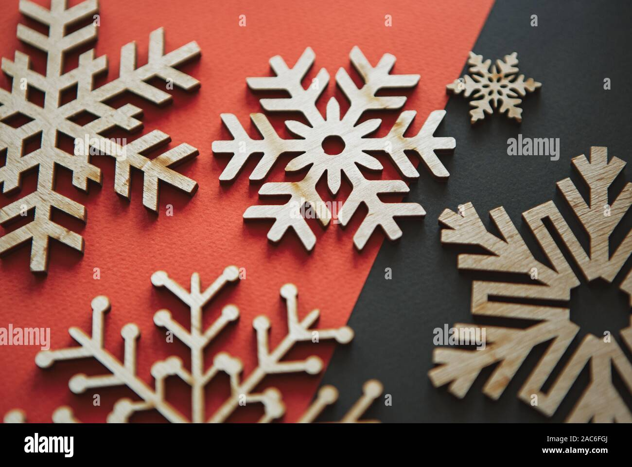 Wooden Rustic Snowflakes In Flat Lay On Red Black