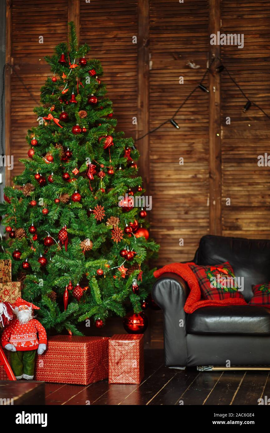 Green Christmas Tree Decorated With Red Toys Ornaments Pine