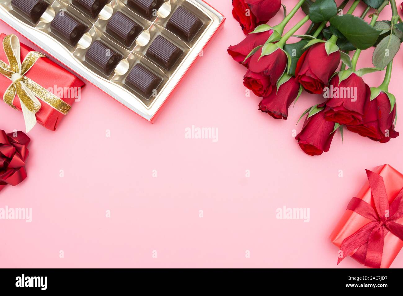 Valentine S Day Red Roses Gift Boxes And Chocolate Box With Ribbon Over Pinkl Background Flat Lay Birthday Abstract Background With Copy Space Stock Photo Alamy