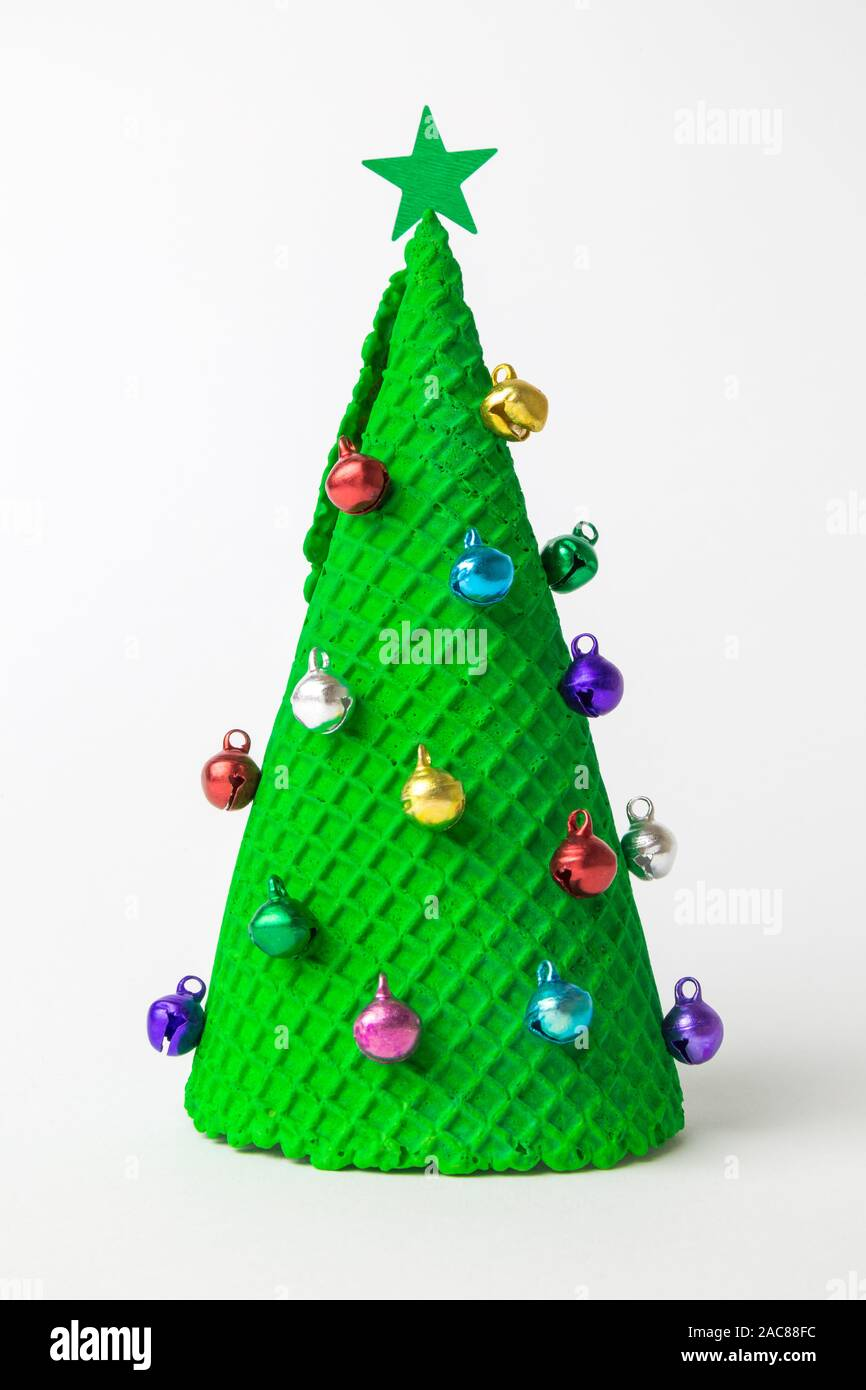 Christmas Tree Abstract Made Of Ice Cream Cone And Miniature Multicolored Baubles With Star On White Stock Photo Alamy