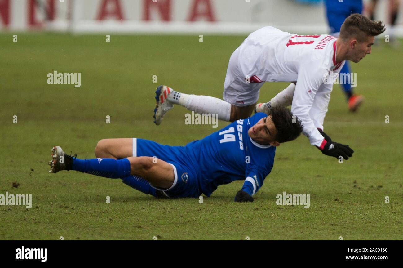 Indiana University's Joshua Penn (11) collides with University California Santa Barbara's Mate Restrepo Mejia (5) during an NCAA tournament sweet 16 soccer game at Armstrong Stadium, Sunday, December 1, 2019 in Bloomington, Indiana. IU lost to UCSB 1-0 in overtime. UCSB's Will Baynham scored the goal to upset the Hoosiers on OT. Stock Photo