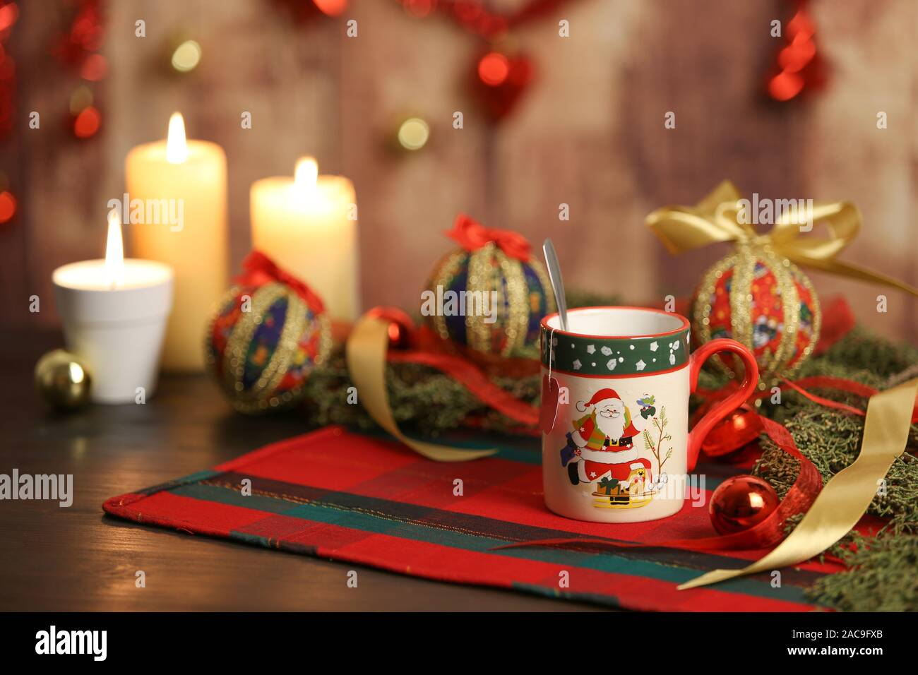 Christmas Mug With Empty Tea Label On Christmas Table Cloth With Around Pine Branches Decoupage Baubles With Lit Candles And Hanging Christmas Decor Stock Photo Alamy