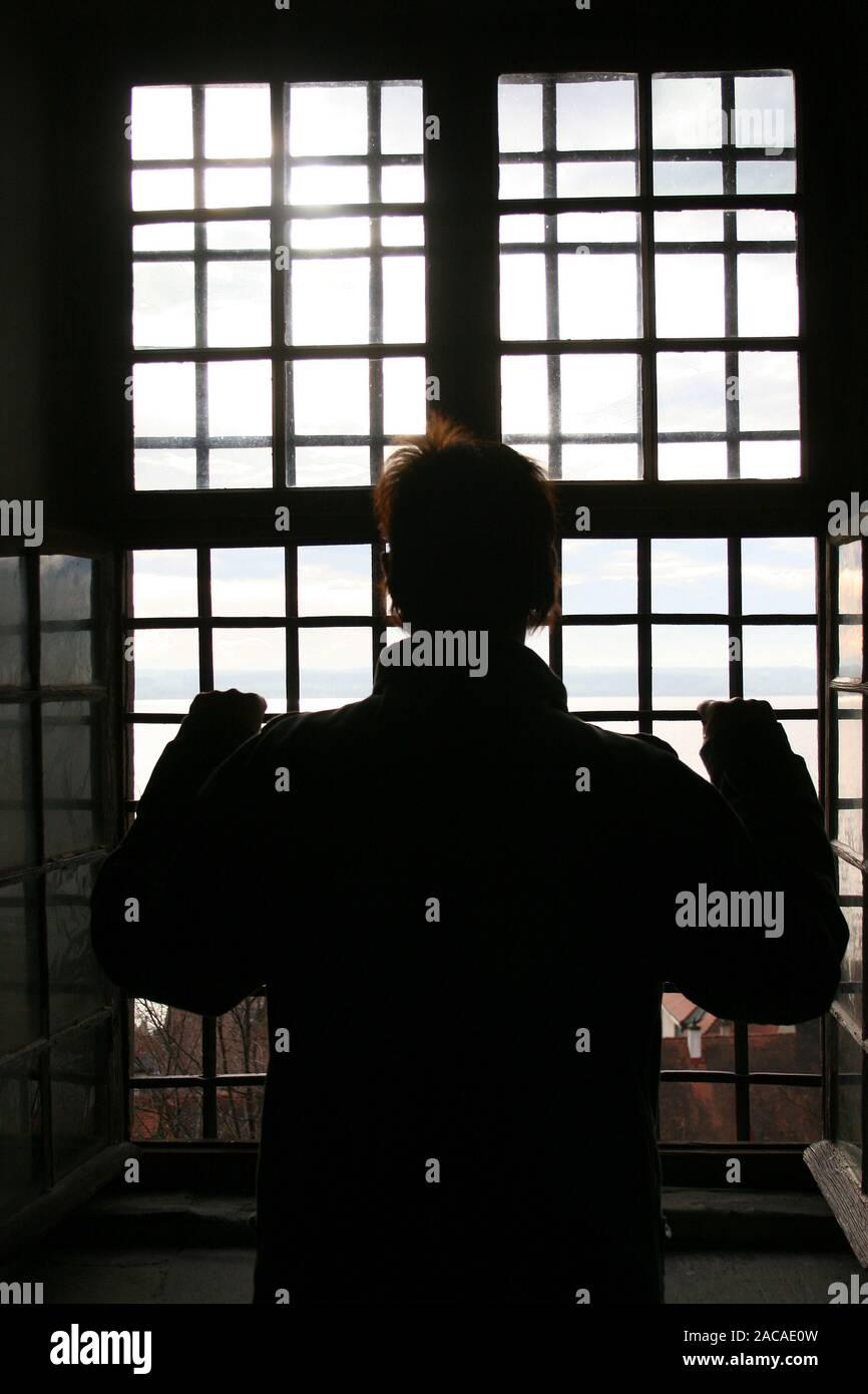Behind lattice - jailed Stock Photo