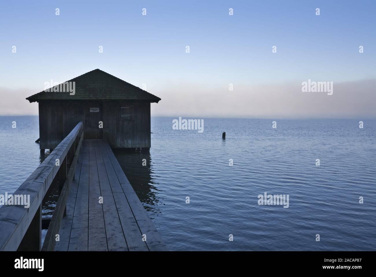 boatshouse at Kochelsee with fog, upper bavaria Stock Photo