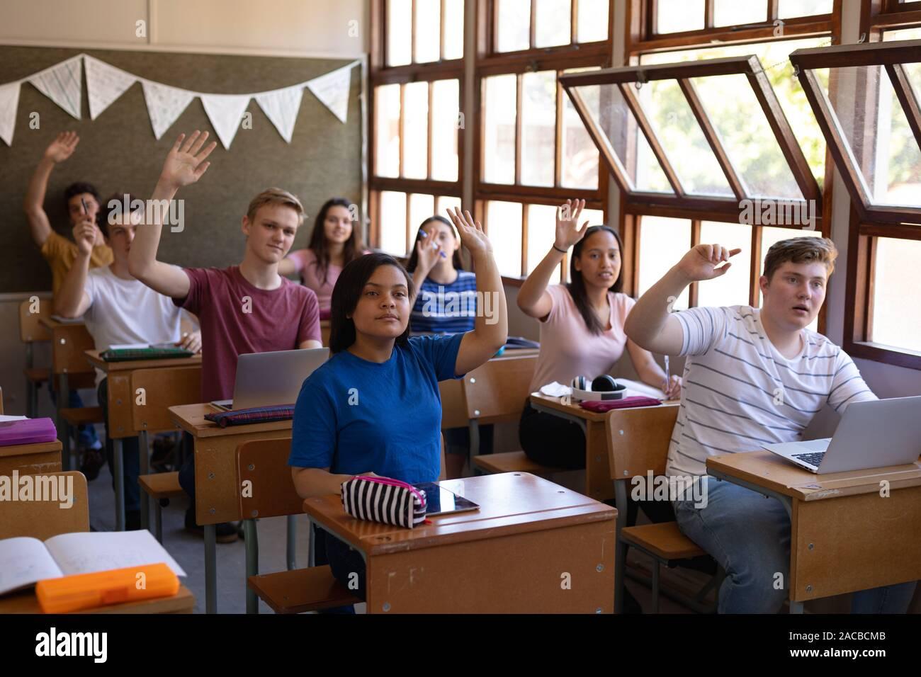 Teenagers in school classroom Stock Photo