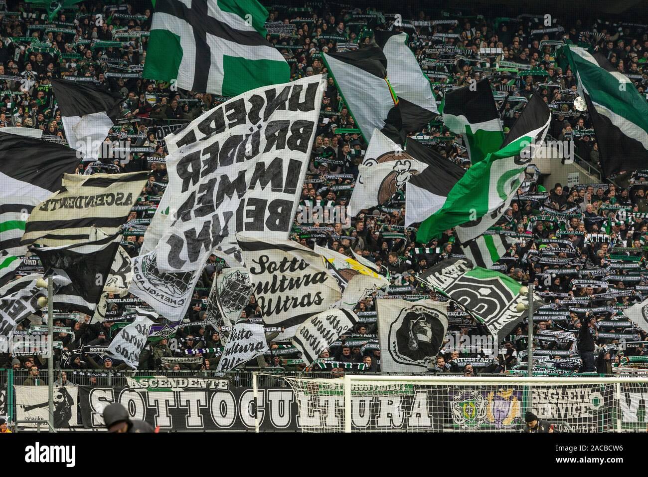 sports, football, Bundesliga, 2019/2020, Borussia Moenchengladbach vs. SC Freiburg 4-2, Stadium Borussia Park, visitors, Gladbach football fans in the Nordkurve, flags, DFL REGULATIONS PROHIBIT ANY USE OF PHOTOGRAPHS AS IMAGE SEQUENCES AND/OR QUASI-VIDEO Stock Photo