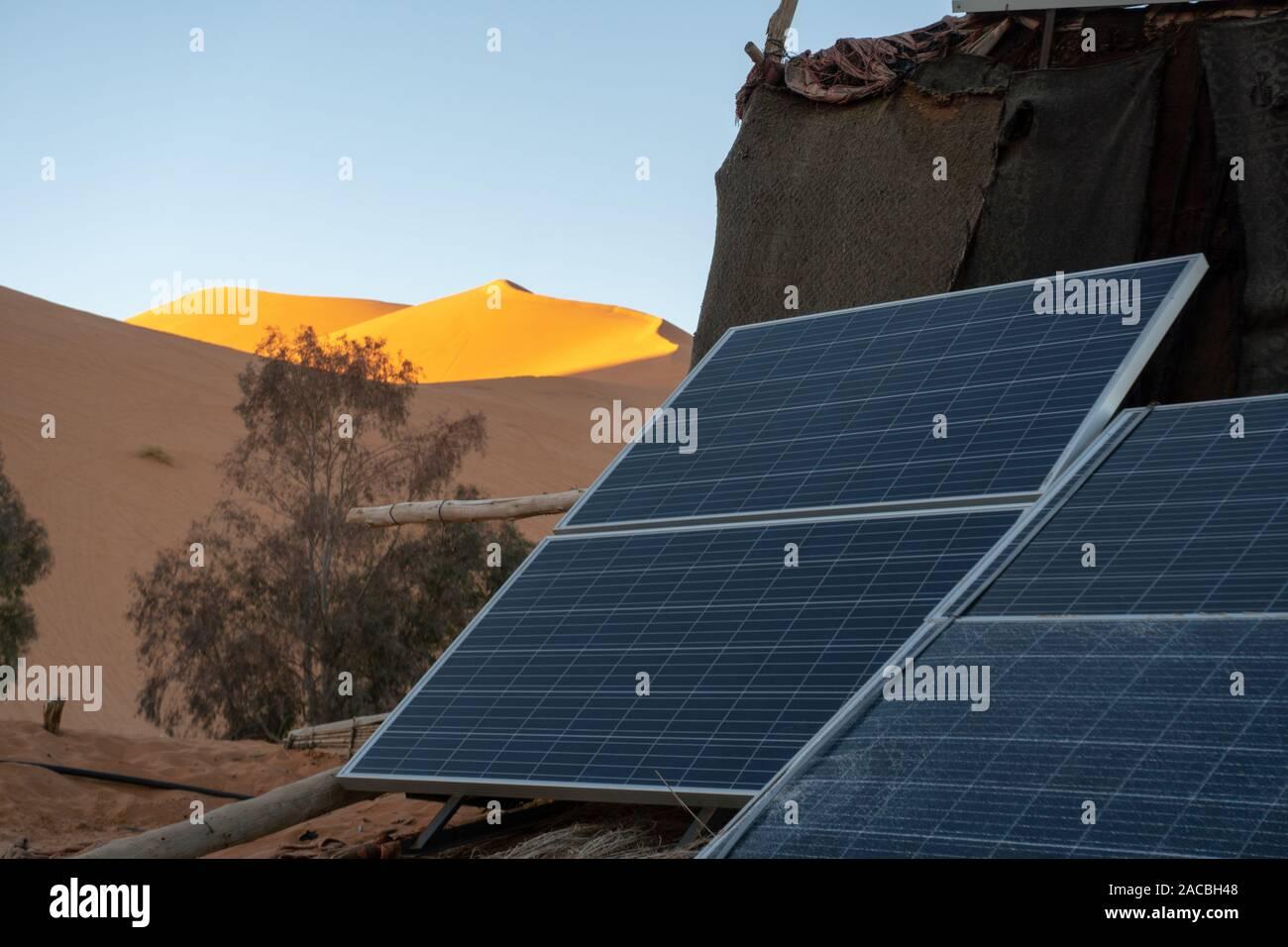 Solar energy panel in the oasis at desert. Sun as energy ...
