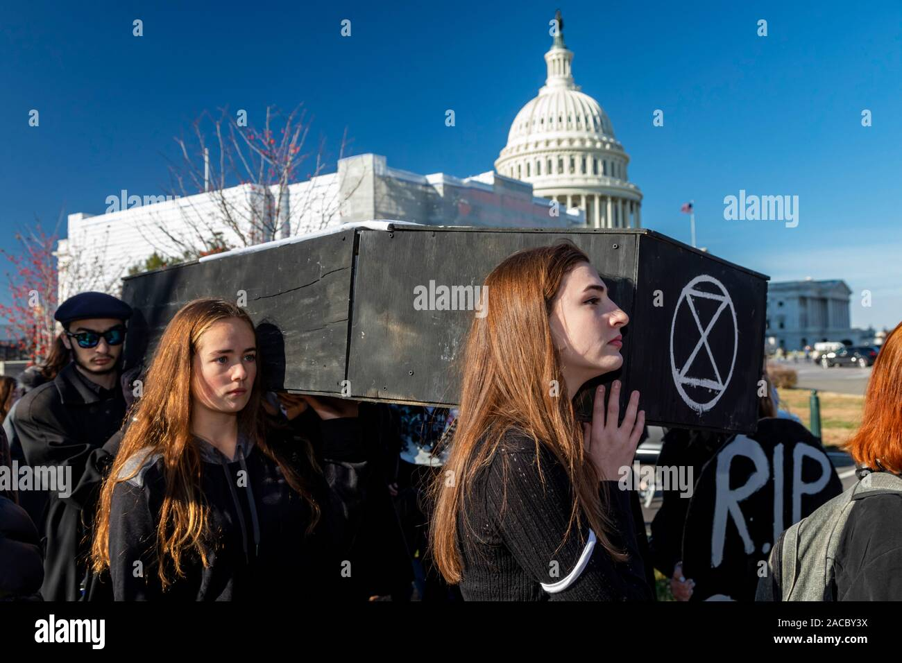 """Washington, DC - Young activists held a """"Funeral for Future"""" on Capitol Hill to demand that governments address the crisis of climate change. It was p Stock Photo"""