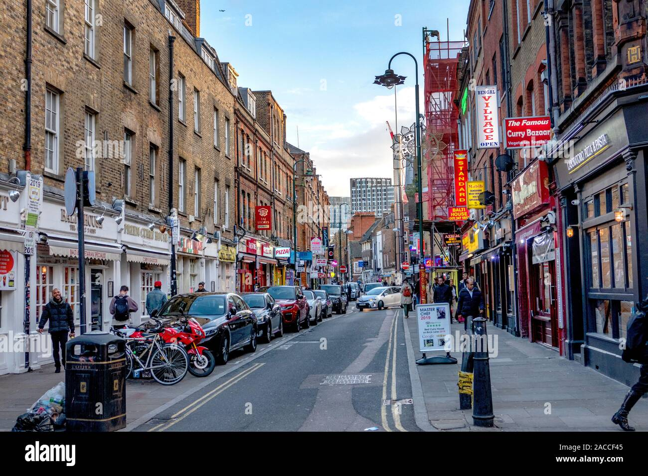 The famous Brick Lane street in the East End of London, England. The lane is also known as Banglatown and is a centre for the Bangladeshi community. Stock Photo