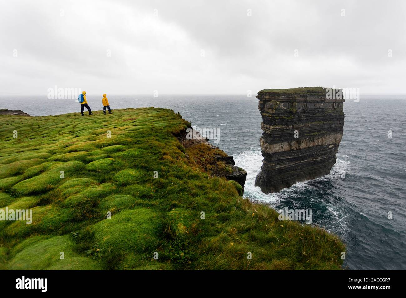 Downpatrick Head, Ballycastle, County Mayo, Donegal, Connacht region, Ireland, Europe. Mother and s watching the sea stack from the top of the cliff. Stock Photo