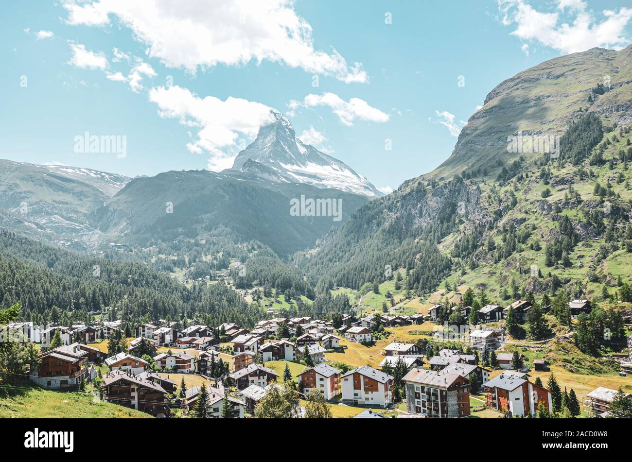 Picturesque Alpine village Zermatt in Switzerland in the summer season. Famous Matterhorn mountain in the background. Typical Alpine mountain huts. Swiss Alps, Alpine landscapes. Stock Photo