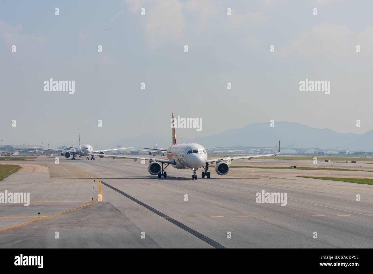 Hong Kong, OCT 20: Airplane ready to take off from the famous Hong Kong International Airport on OCT 20, 2019 at Hong Kong, China Stock Photo