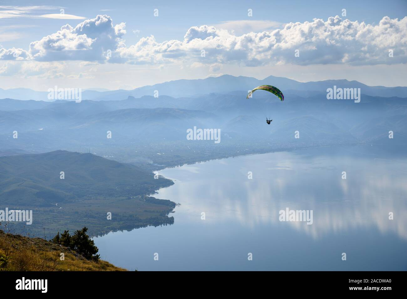 Paragliders in the Galičica National Park above Lake Ohrid in North Macedonia, with Albania in the distance, North Macedonia,  Europe. Stock Photo