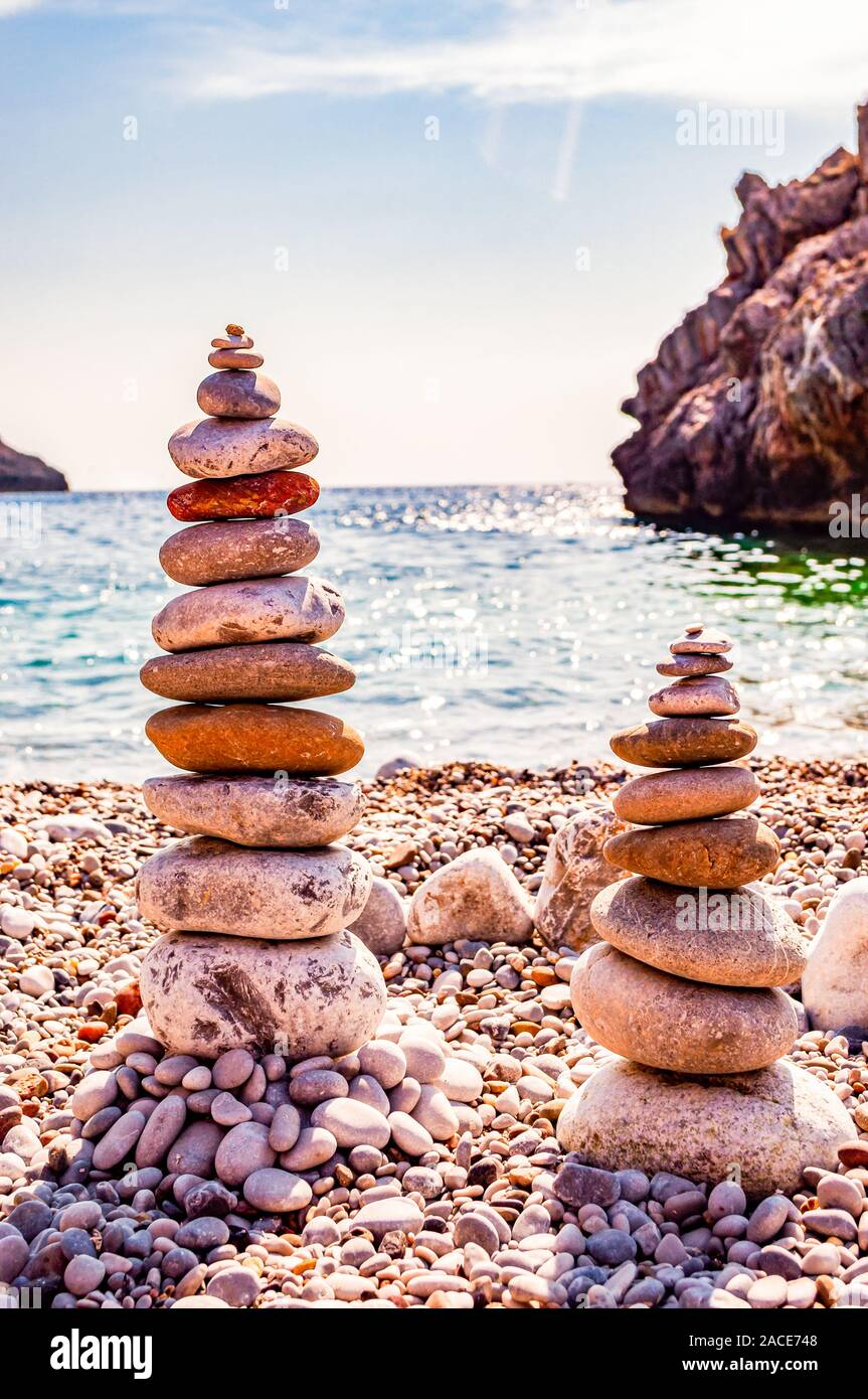 Two Towers Of Flat Stones On The Beach Rock Balancing Or Stone