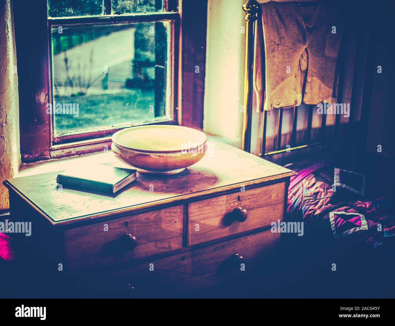 Old Fashioned 19th Century Bedroom Scene With Long Johns, Wash Basin And Bible Stock Photo