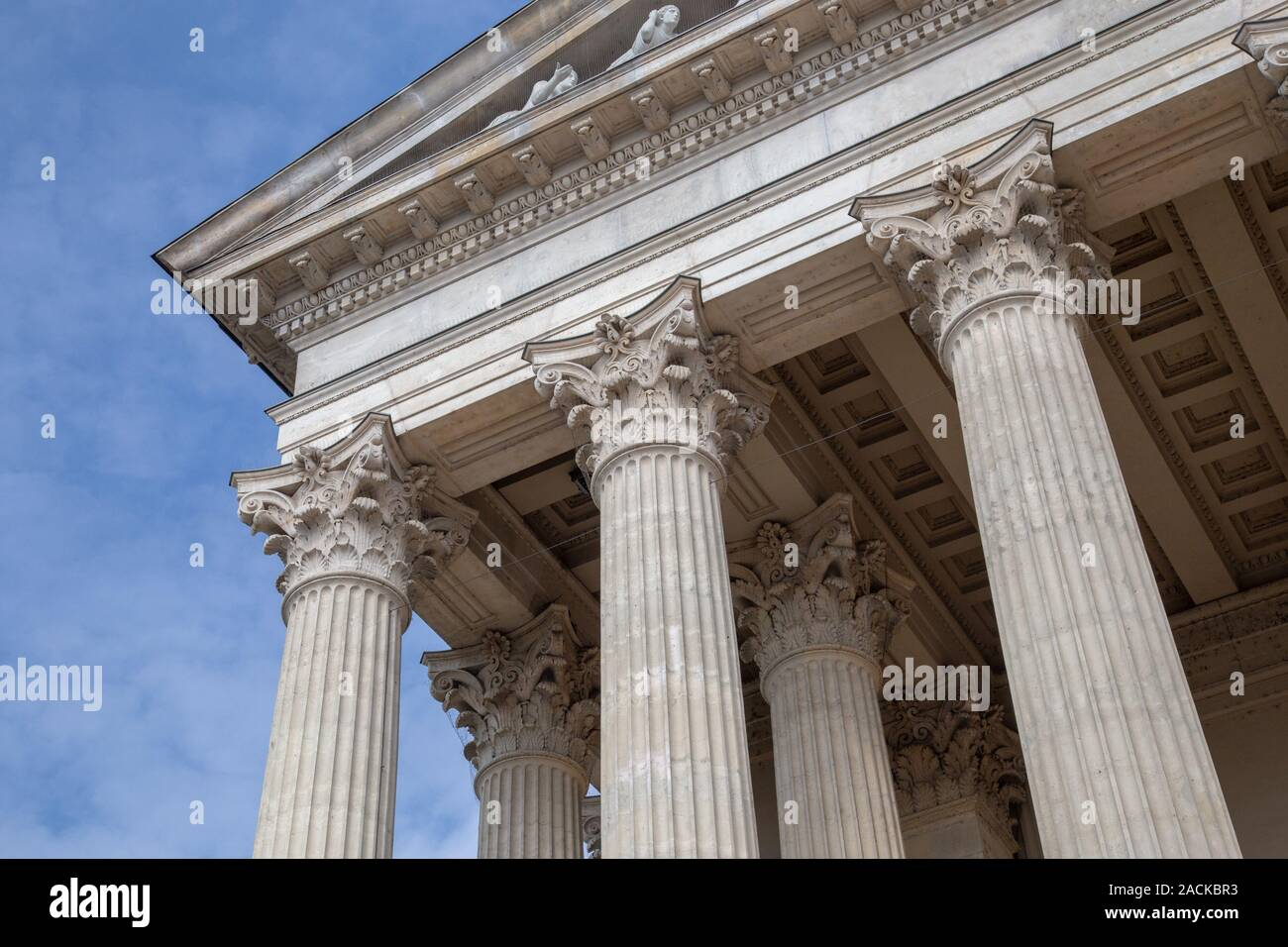 Vintage Old Justice Courthouse Column. Neoclassical colonnade with corinthian columns as part of a public building resembling a Greek or Roman temple. Stock Photo