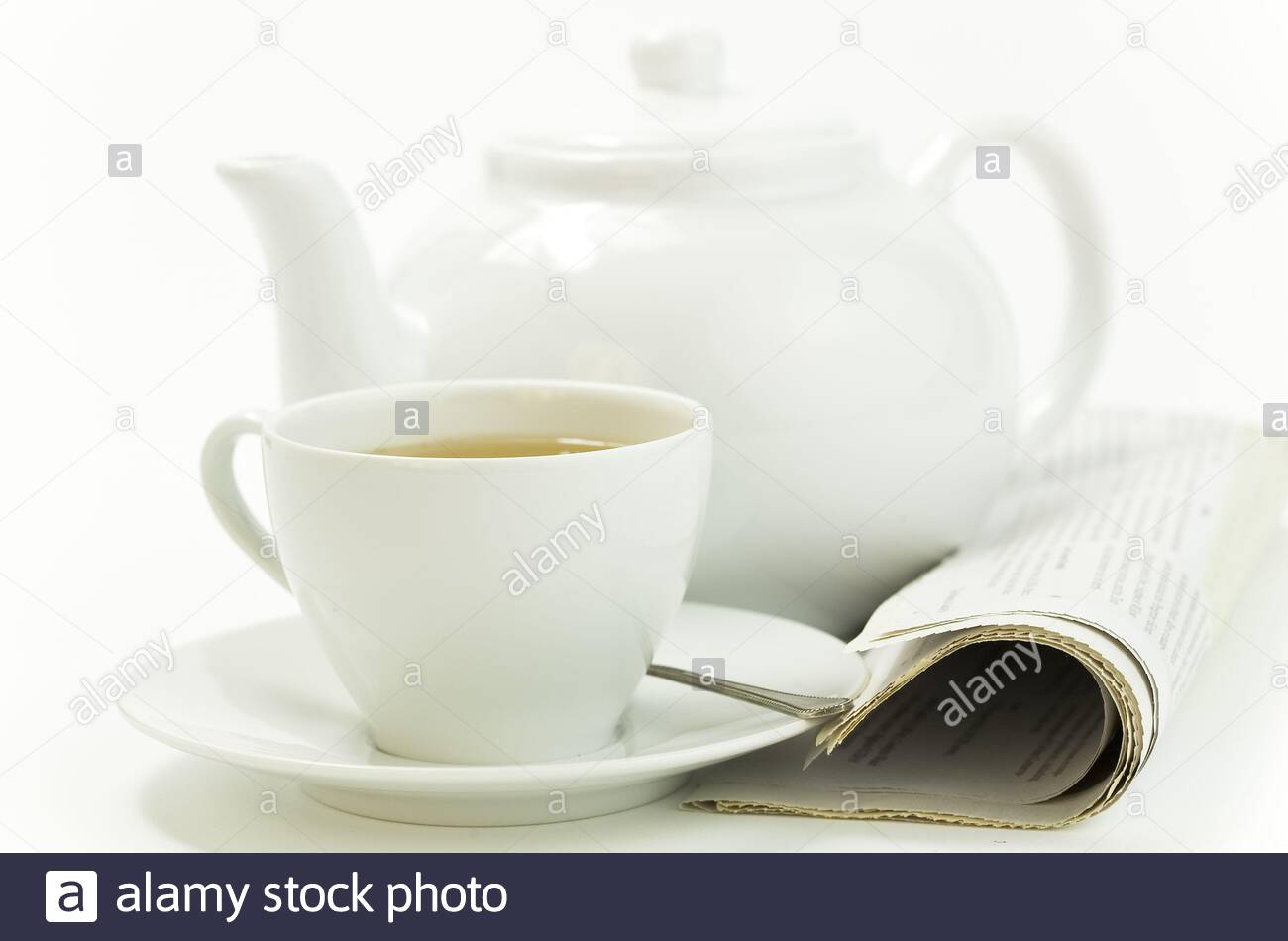 morning cup of tea and press on white Stock Photo