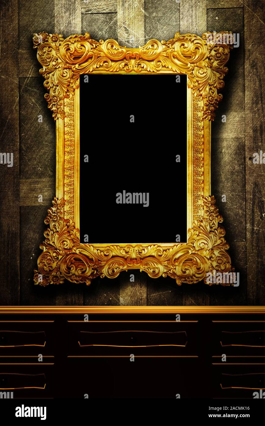 Gallery display - vintage gold frames on an old timber wall Stock Photo