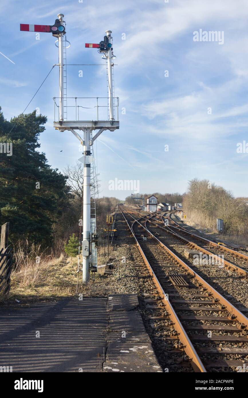 Semaphore signals at north junction of Appleby railway station on the Settle to Carlile railway line. Stock Photo