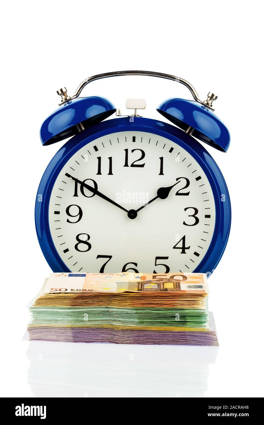 Alarm clocks and banknotes Stock Photo