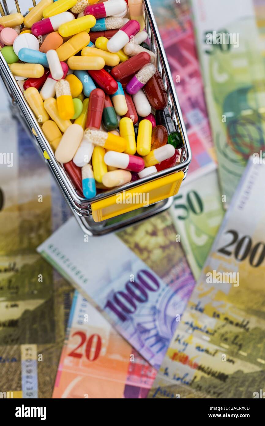 Tablets, shopping trolleys, banknotes Stock Photo