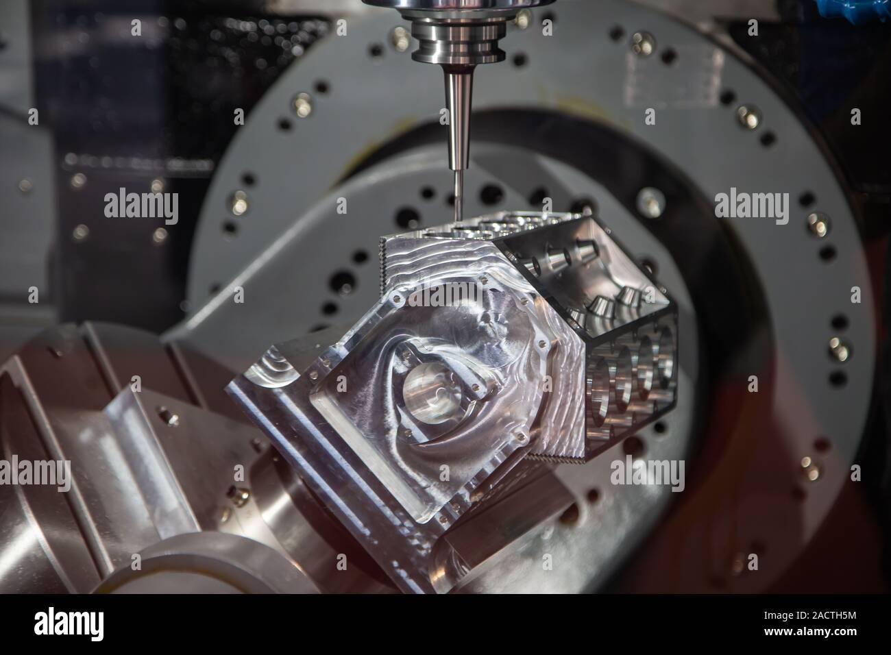 Modern industry CNC milling machine cutting sample workpiece Stock Photo