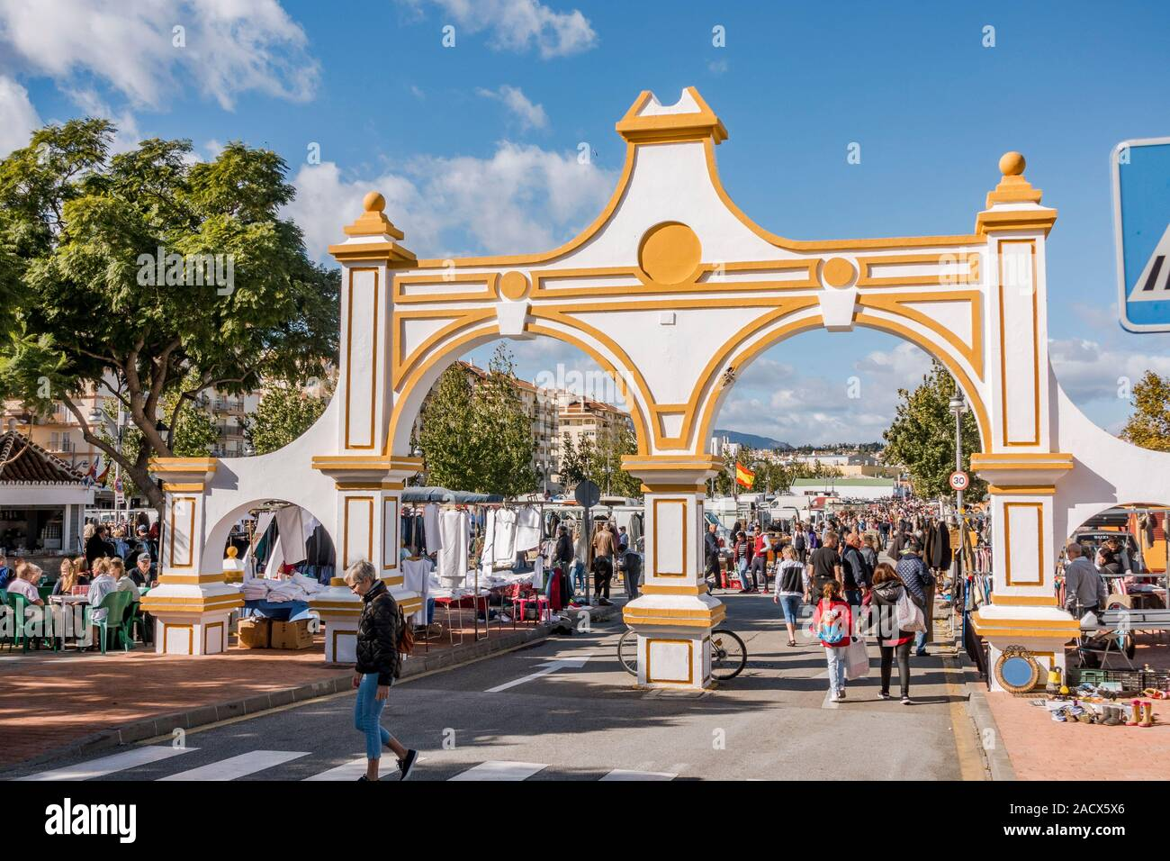Fuengirola, Spain. Stall and people strolling on weekly Flea Market, second hand market in Fuengirola, Costa del sol, Spain. Stock Photo