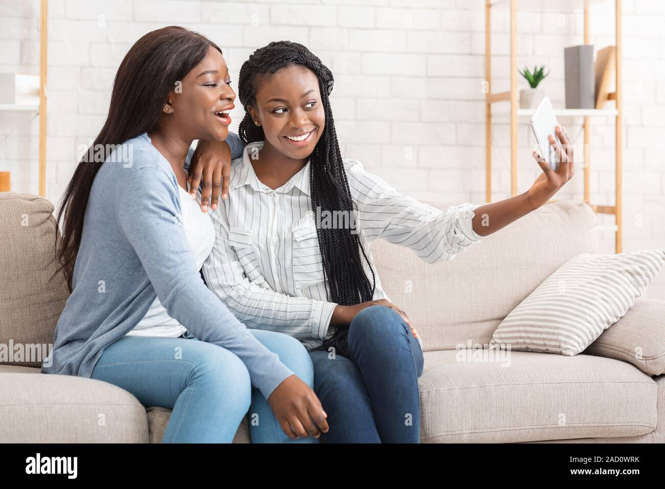 Tremendous Cheerful Black Girls Taking Selfie While Sitting On Couch At Home Natural Hairstyles Runnerswayorg