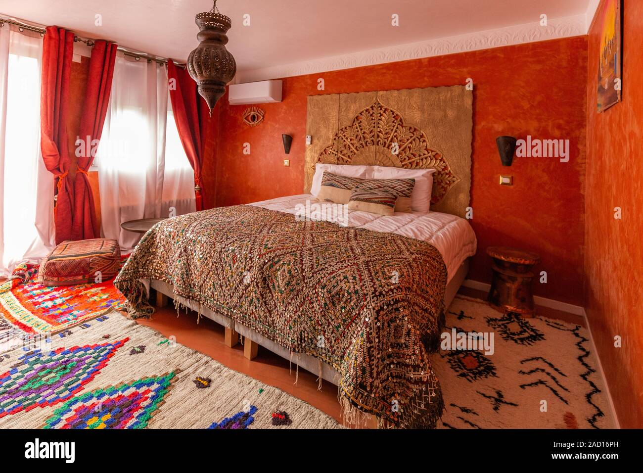 Picture of: Beautiful Design Of An Oriental Interior Of A Bedroom With Kingsize Bed Wooden Bedboard And Furniture Stock Photo Alamy