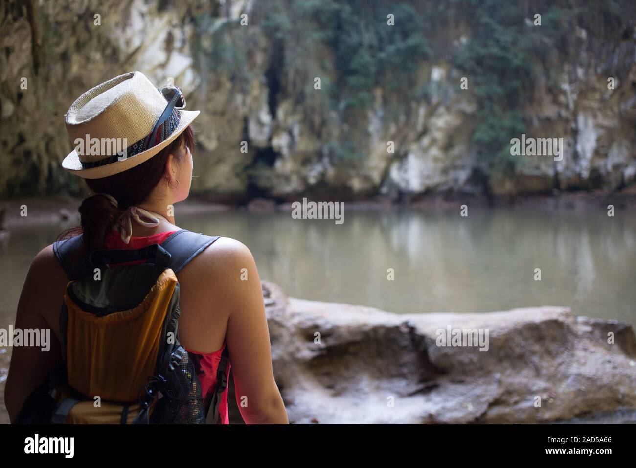 Brunette in hat among mountains Stock Photo