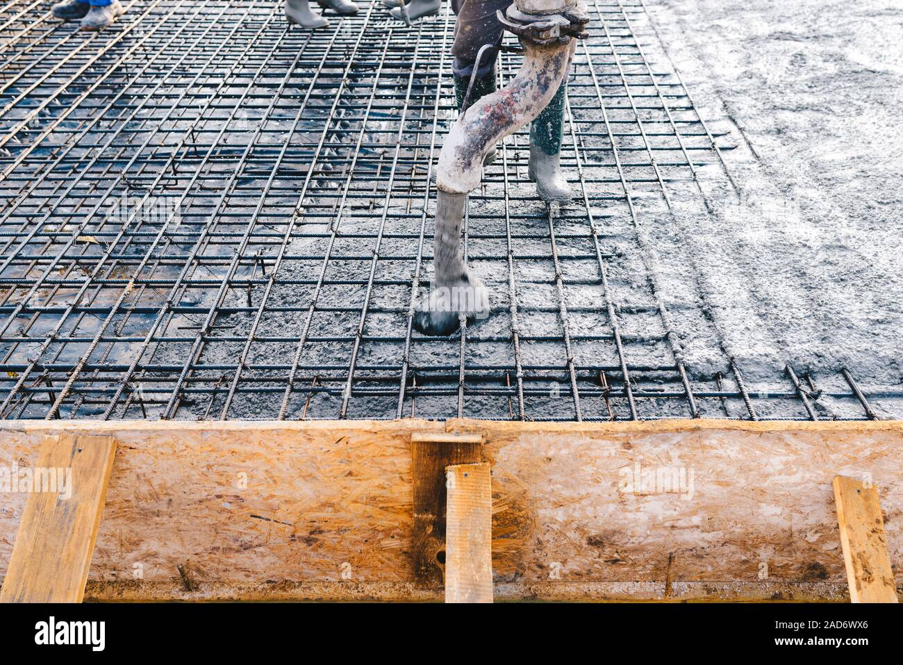 Concrete pouring during concreting floors of buildings in construction Stock Photo