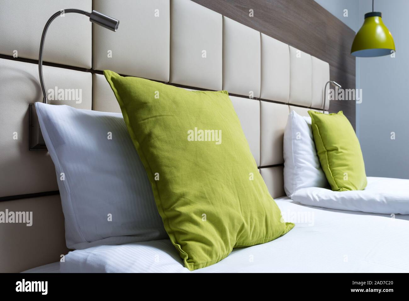 Green Pillow Reading Lamps And Leather Bed Headboard In Modern Bedroom Stock Photo Alamy