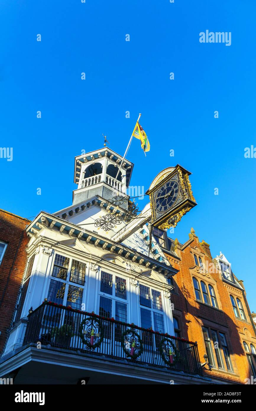 The iconic Guildhall with its distinctive historic medieval clock dated 1683 in High Street, Guildford, county town of Surrey, southeast England, UK Stock Photo