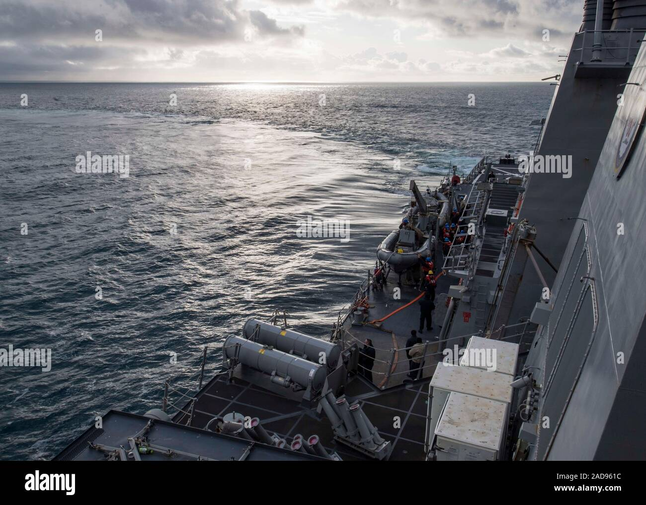 191129-N-TI693-1001    ATLANTIC OCEAN (Nov. 29, 2019) - Sailors assigned to the Arleigh Burke-class guided-missile destroyer USS Carney (DDG 64) man the boat deck for a man overboard drill as part of the U.K.-led Flag Officer Sea Training (FOST), Nov. 29, 2019. FOST's training is designed to prepare all types of navy vessels and auxiliaries for peacetime, peace-support, and war-fighting operations. Carney, forward-deployed to Rota, Spain, is on its seventh patrol in the U.S. 6th Fleet area of operations in support of regional allies and partners as well as U.S. national security interests in E Stock Photo