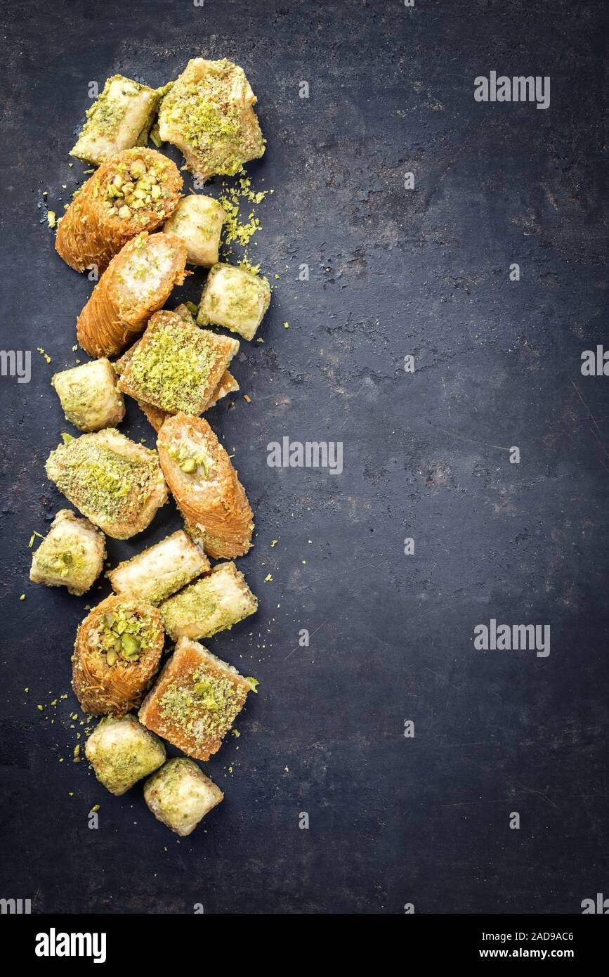 Traditional Oriental baklava collection as top view on a black board with copy space right Stock Photo