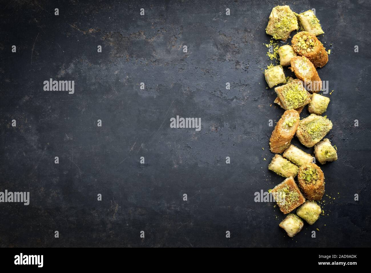 Traditional Oriental baklava collection as top view on a black board with copy space left Stock Photo