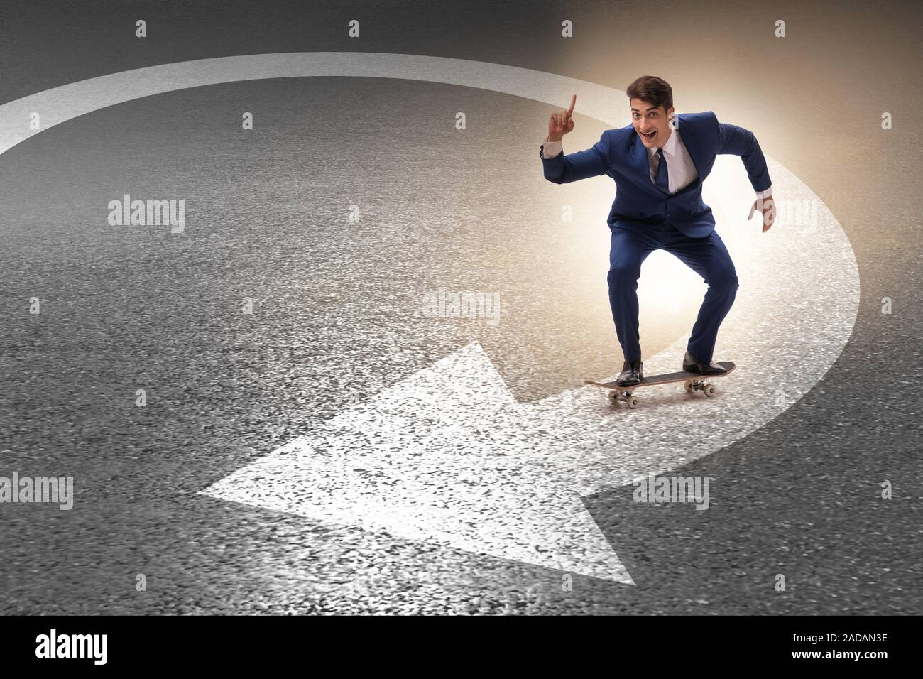 Businessman riding skateboard on financial graph Stock Photo