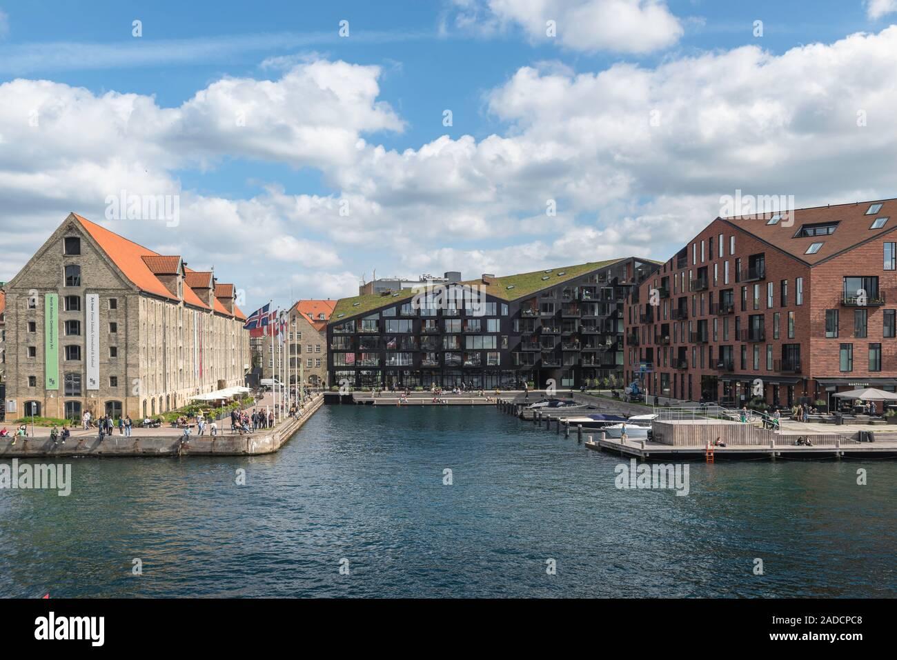 Copenhagen architecture, contrast of styles with 19th century Nordatlantens Brygge (left) and modern Krøyers Plads (right), Christianshavn, Copenhagen. Stock Photo