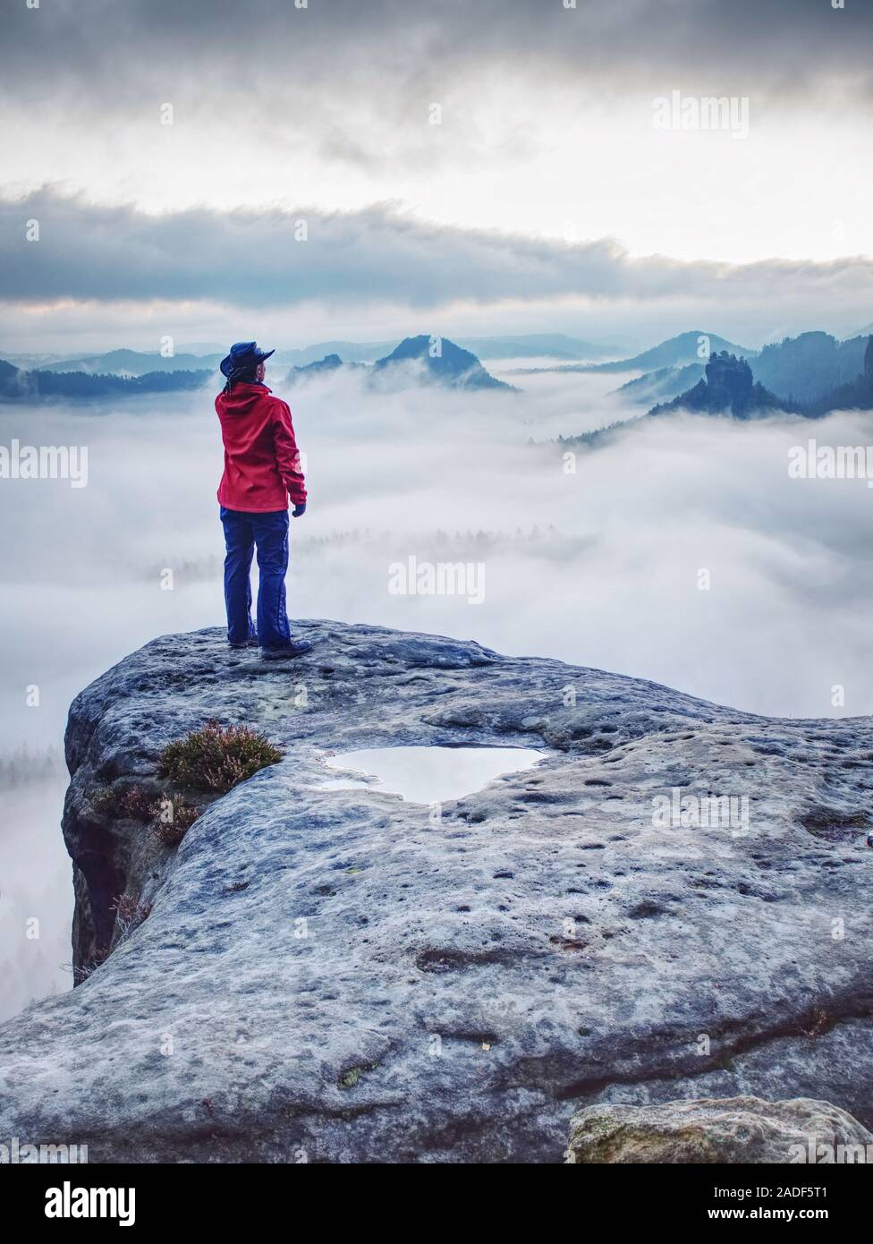 Woman watching sunrise over Himalayas, misty mountains National Park Stock Photo