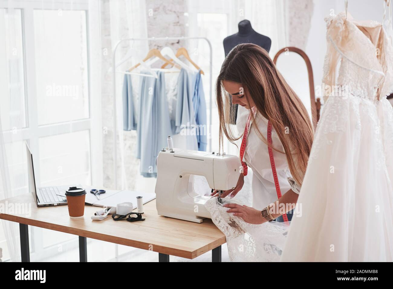 Sewing Process Female Fashion Designer Works On The New Clothes In The Workshop Stock Photo Alamy