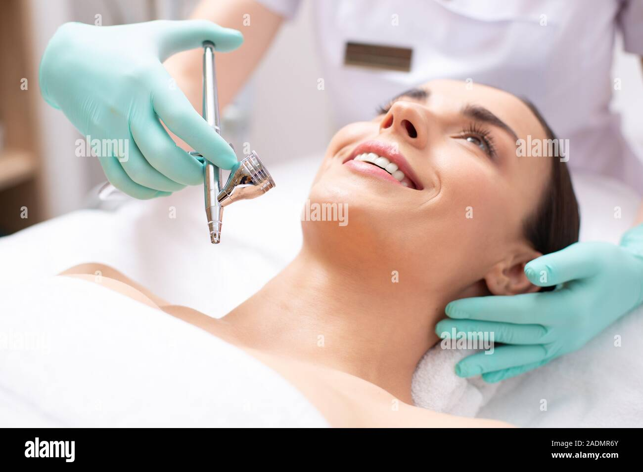 Face of smiling woman and oxygen spray treatment Stock Photo
