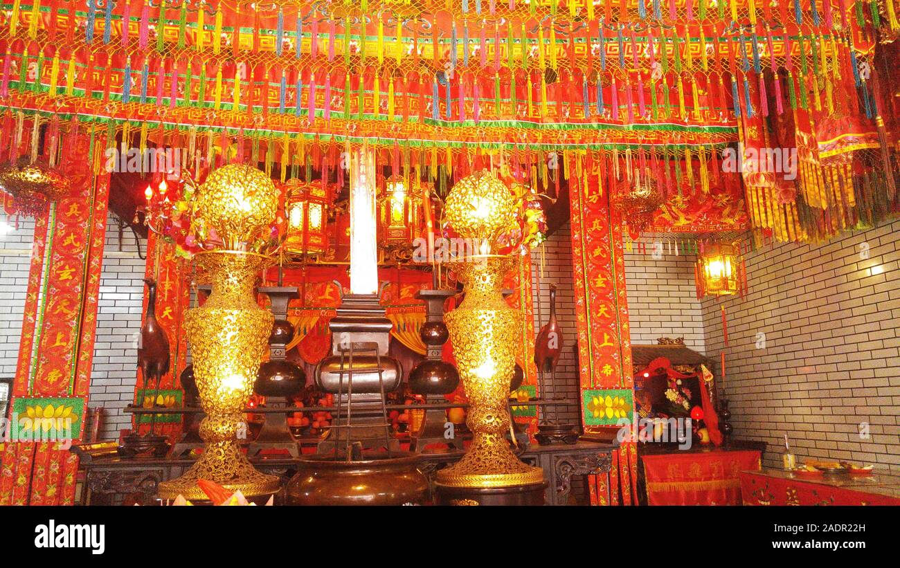 Shenzhen China Women Burn Incense To Worship Buddha In A Decorated Temple Landscape Stock Photo Alamy